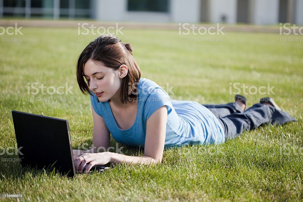 College student on computer outside royalty-free stock photo