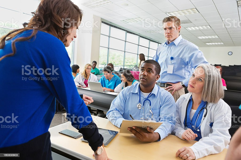 College student signing up for medical nursing seminar or class stock photo