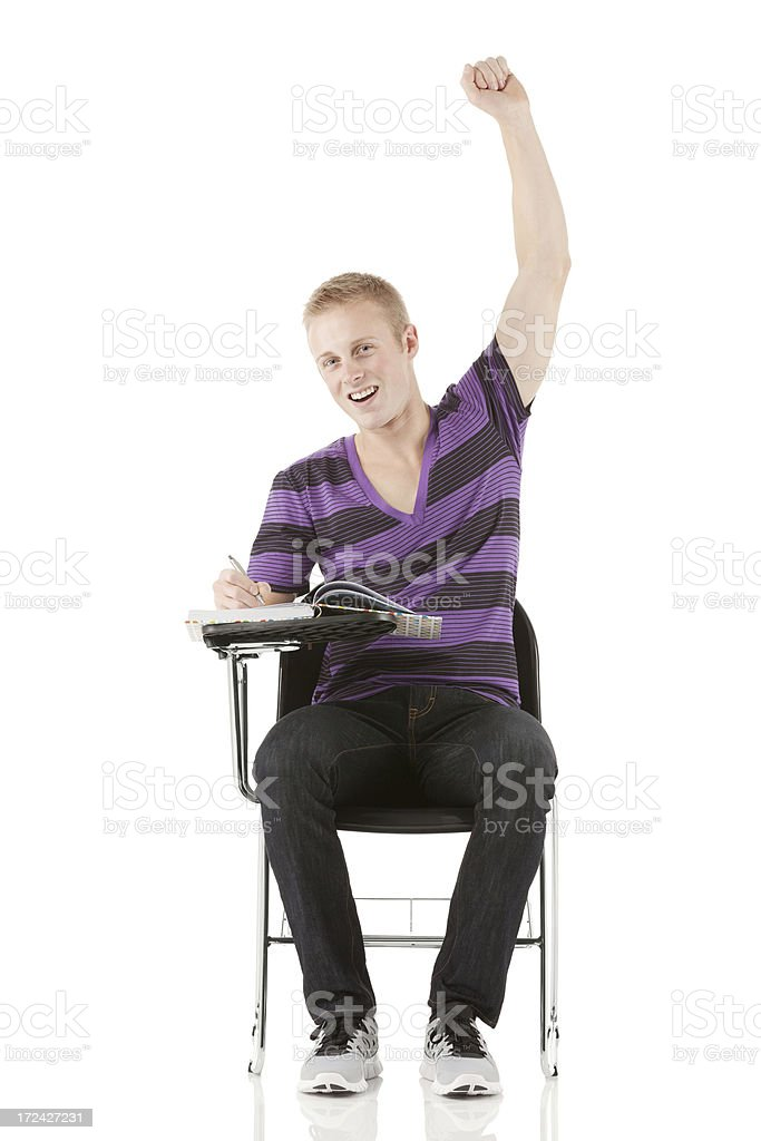 College student sitting on chair raising hand royalty-free stock photo