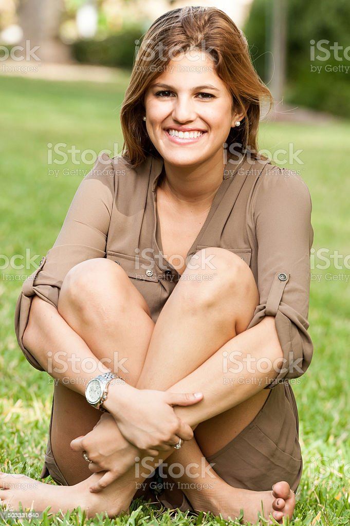 College Student sitting on the Grass stock photo