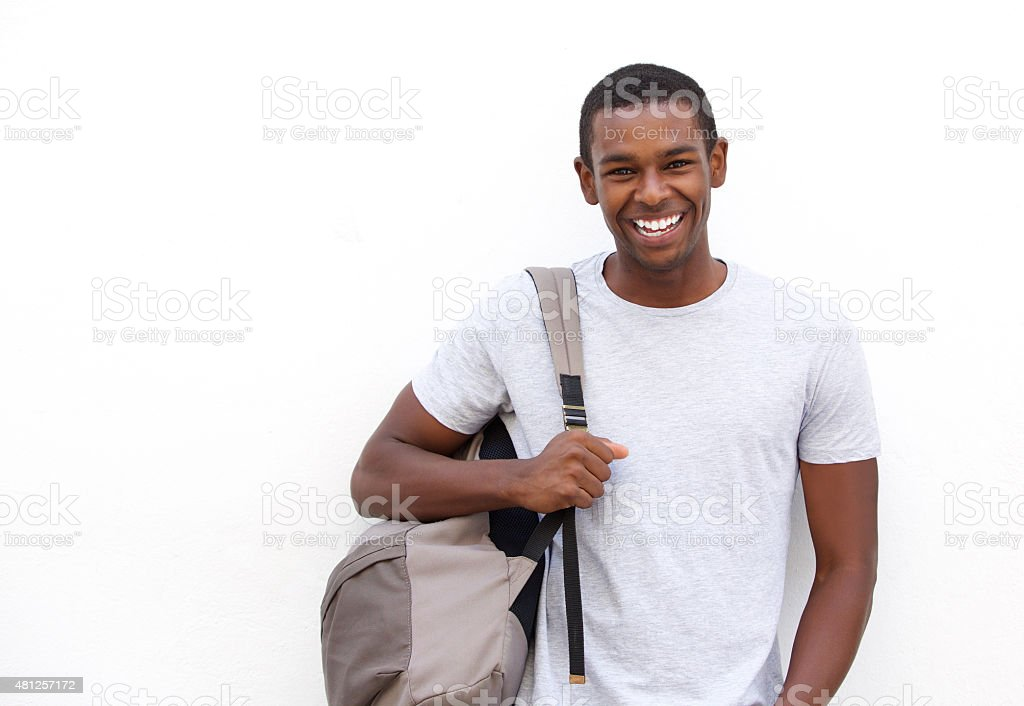 College student smiling with bag stock photo