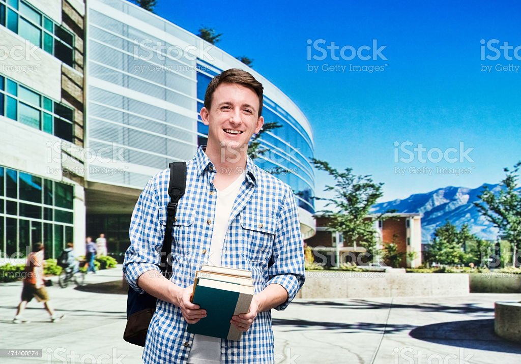 College student standing outside campus stock photo