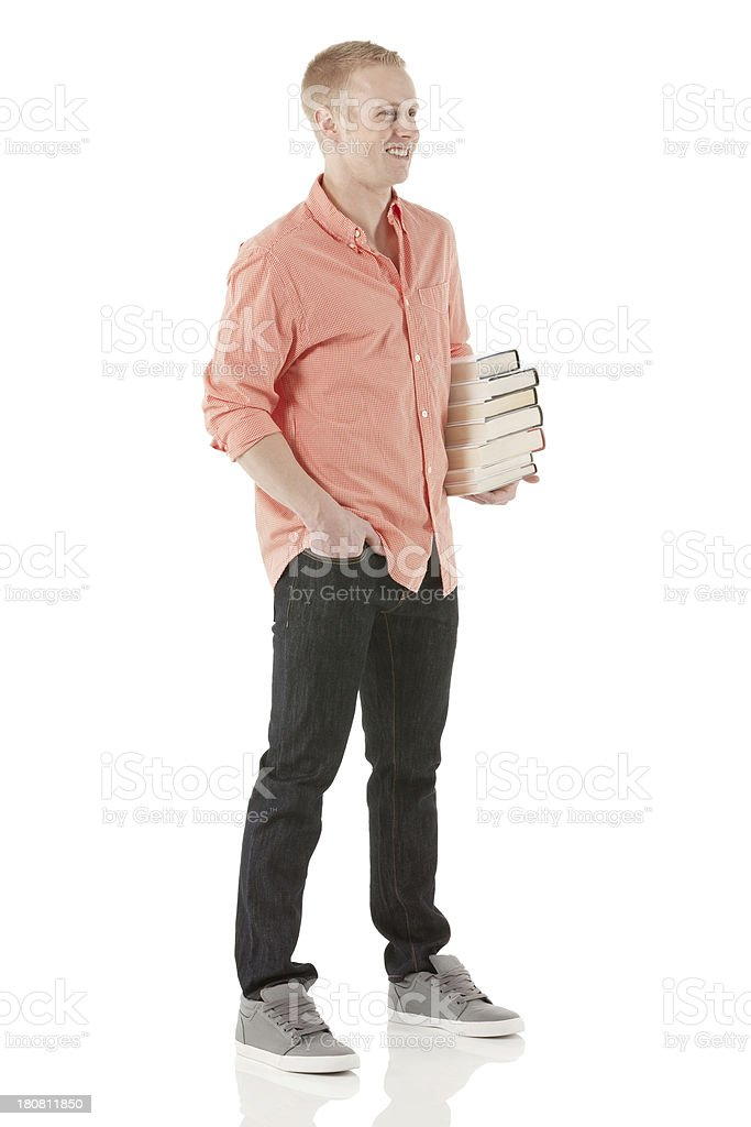 College student standing with stack of books royalty-free stock photo