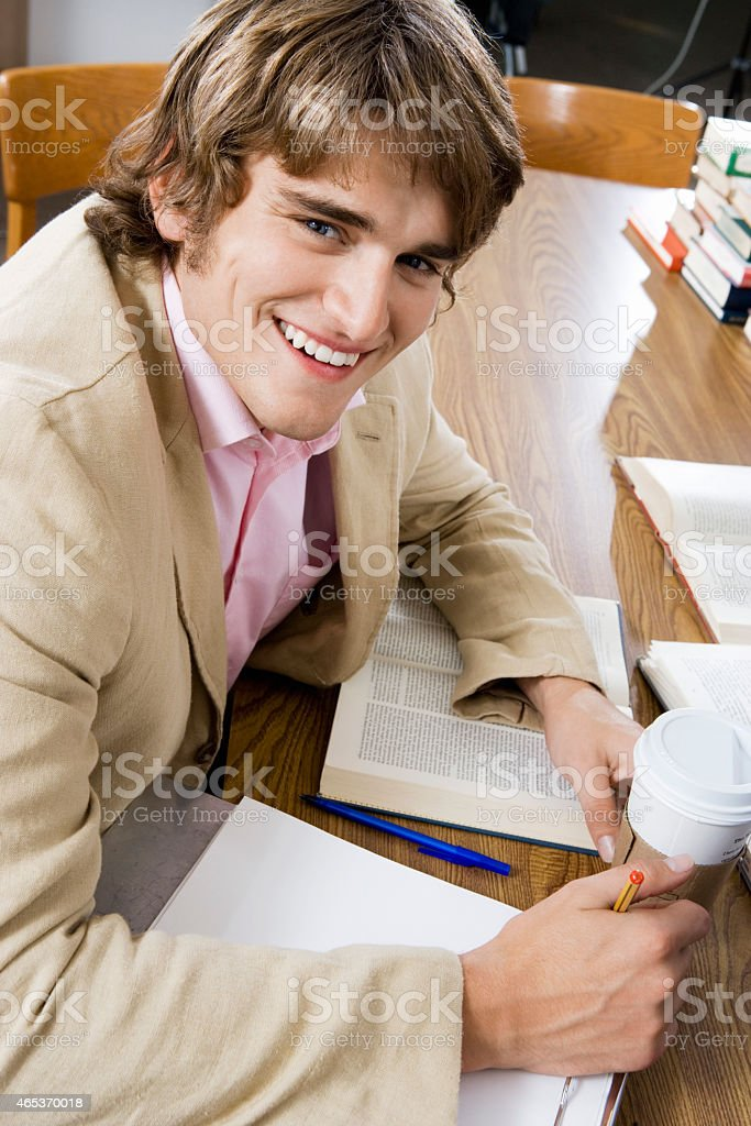 College Student Studying in the Library stock photo