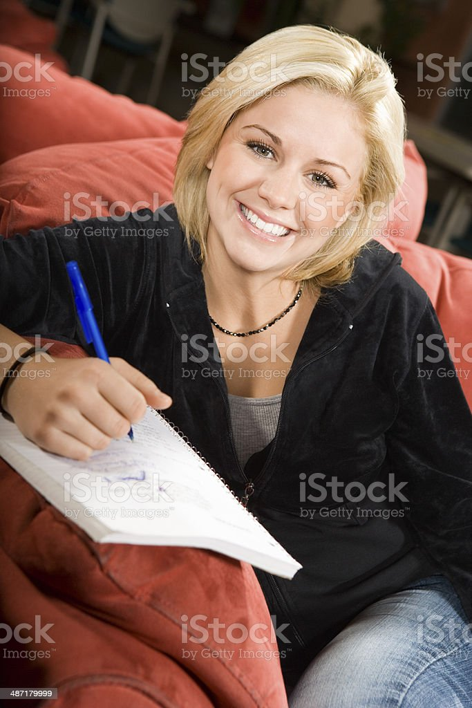 College Student Taking Notes stock photo