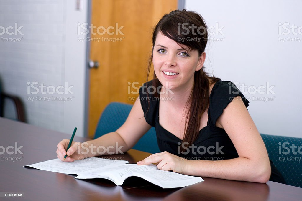 College Student Using Catalogue royalty-free stock photo