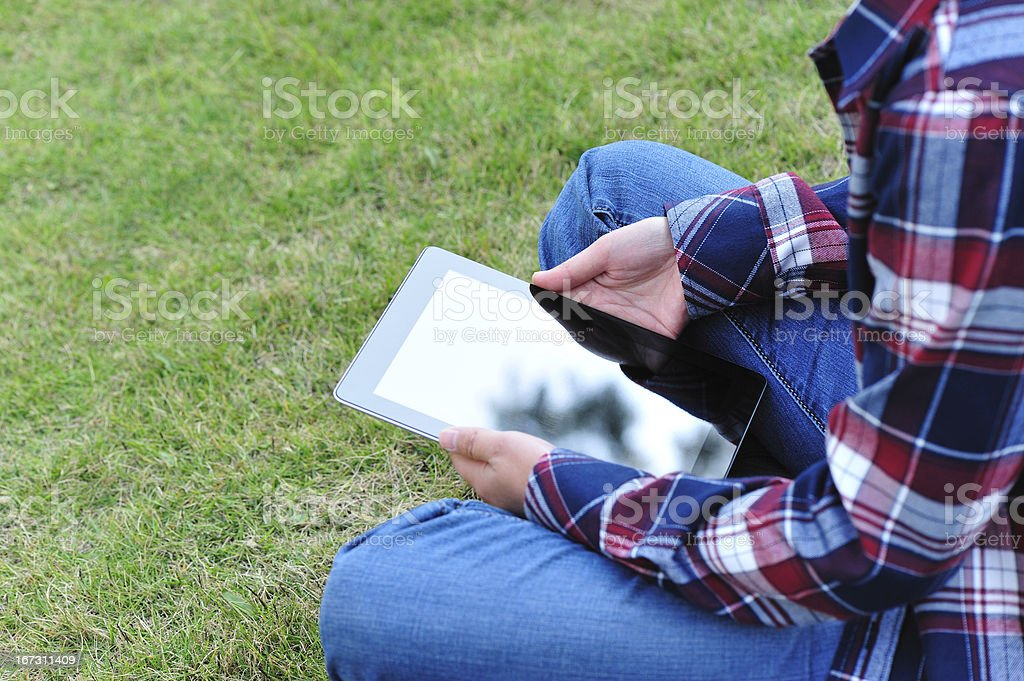 college student using digital tablet outdoor royalty-free stock photo