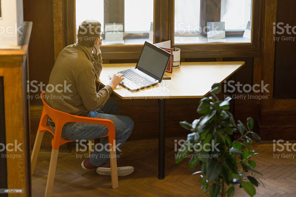 College student using laptop stock photo