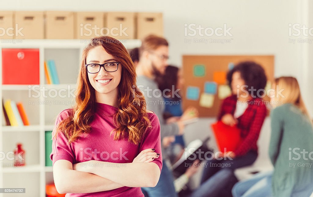 College student with crossed arms looking at camera stock photo