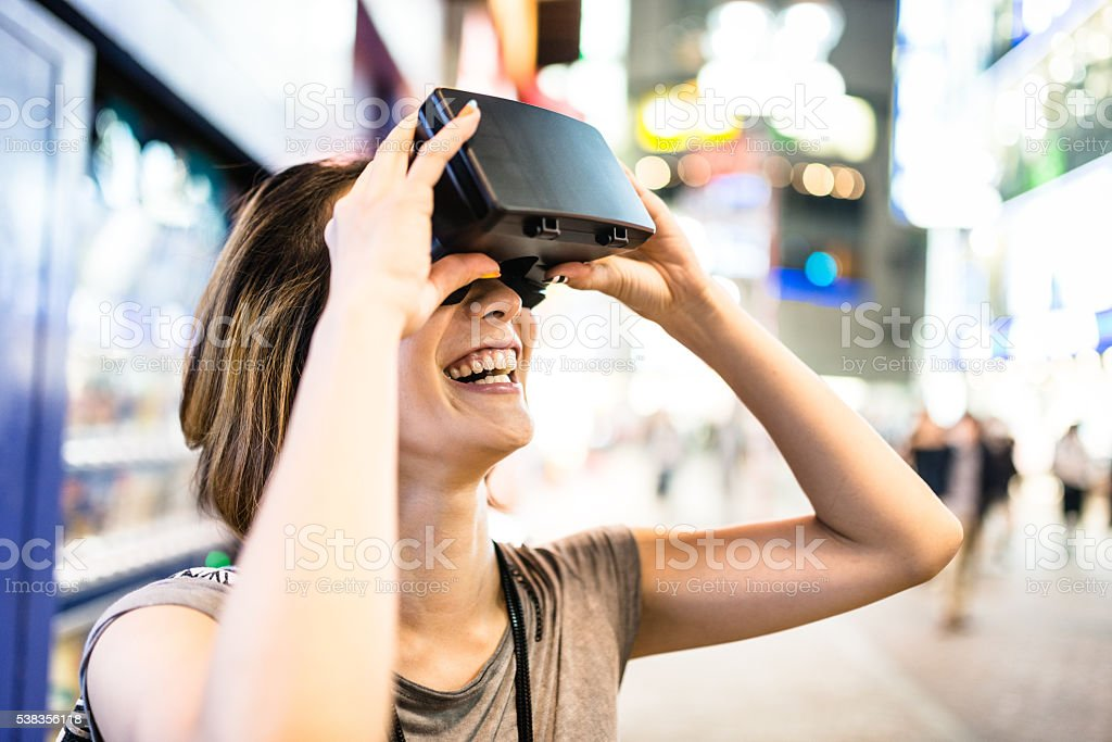 college student woman using the VR simulator in Tokyo stock photo