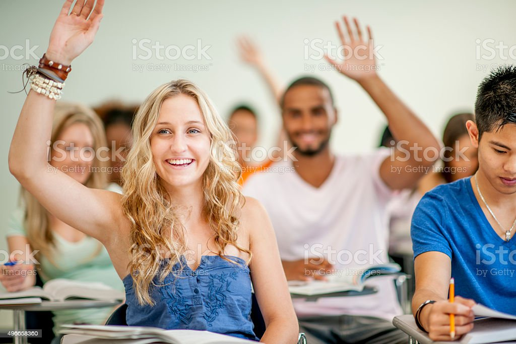 College Students Answering Questions in Class stock photo