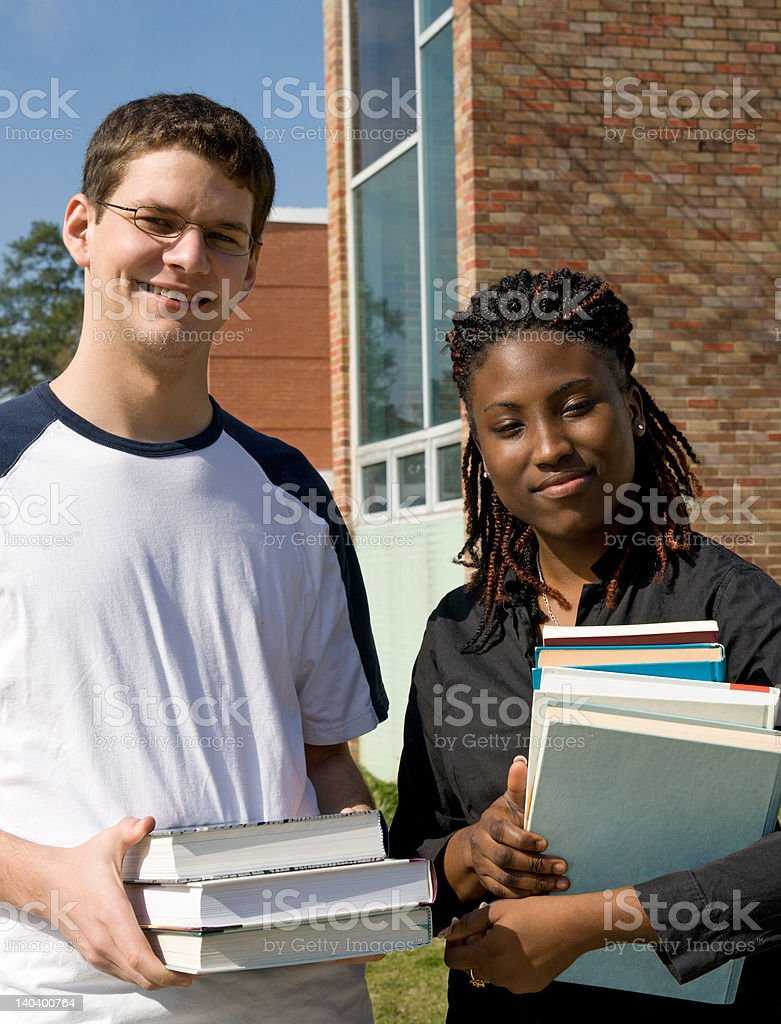 College Students Carrying Books royalty-free stock photo