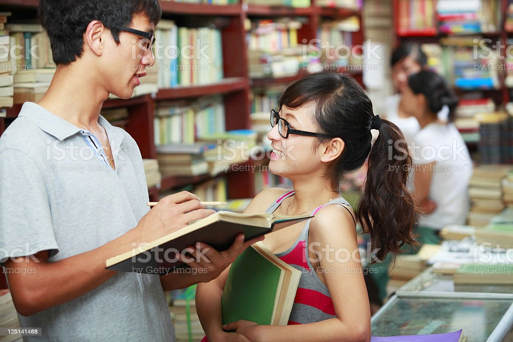 college students discussion in library royalty-free stock photo
