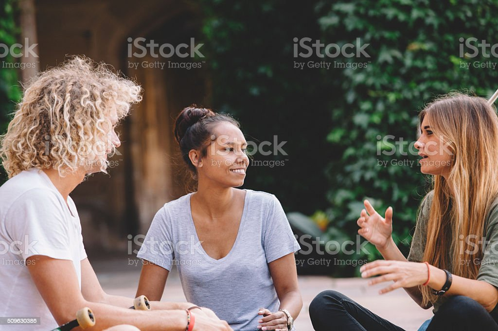 college students having a conversation stock photo