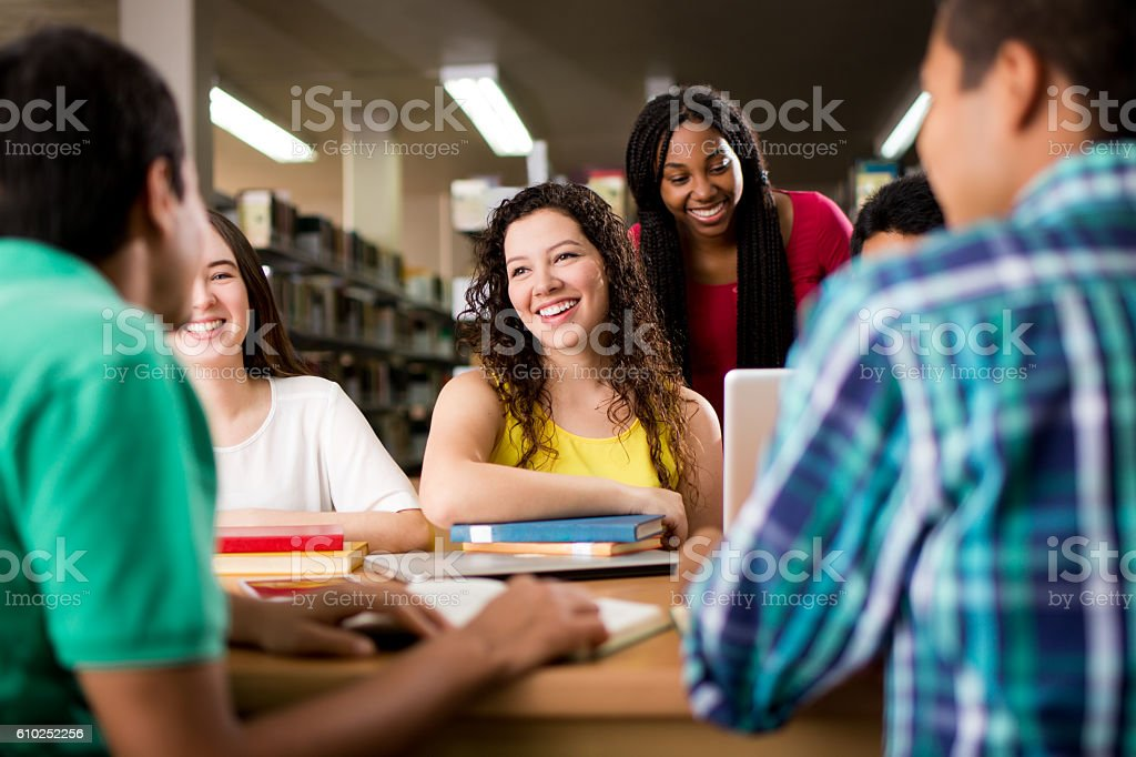 College students having fun at the library stock photo