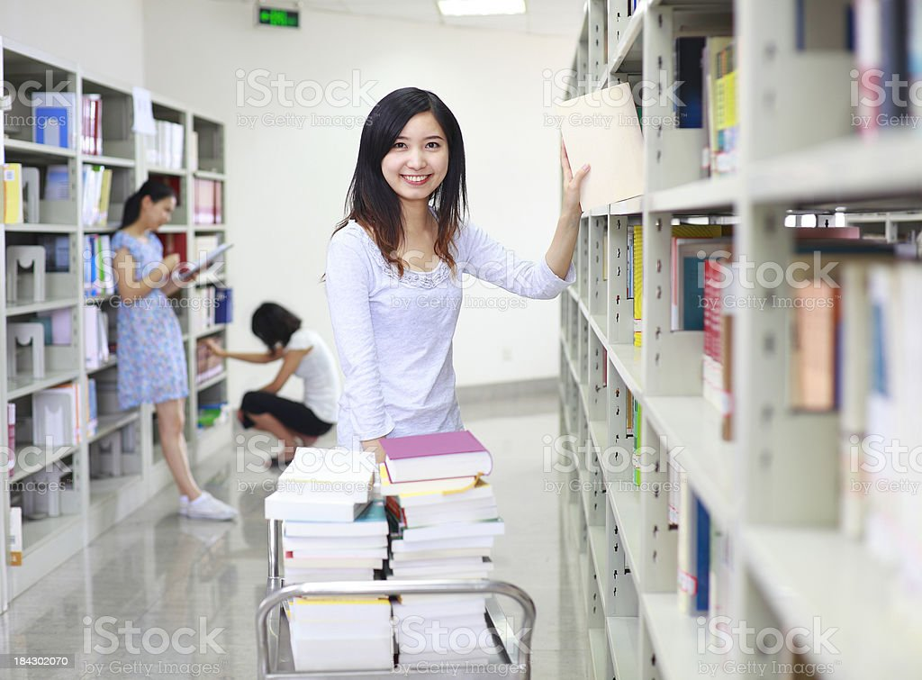 college students in the library royalty-free stock photo
