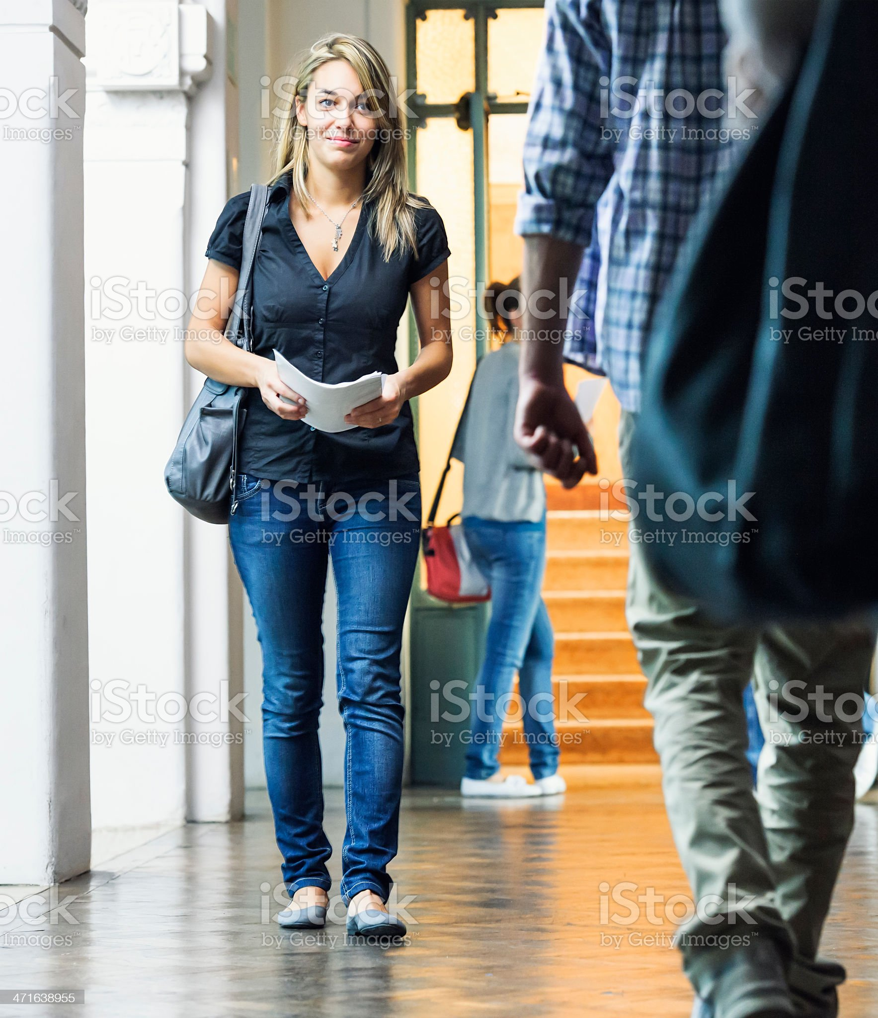 College Students Passing Between Classes in a Corridor royalty-free stock photo