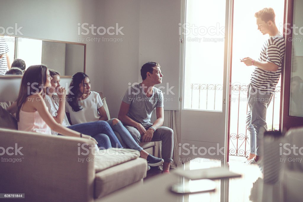 College students relaxing at home stock photo