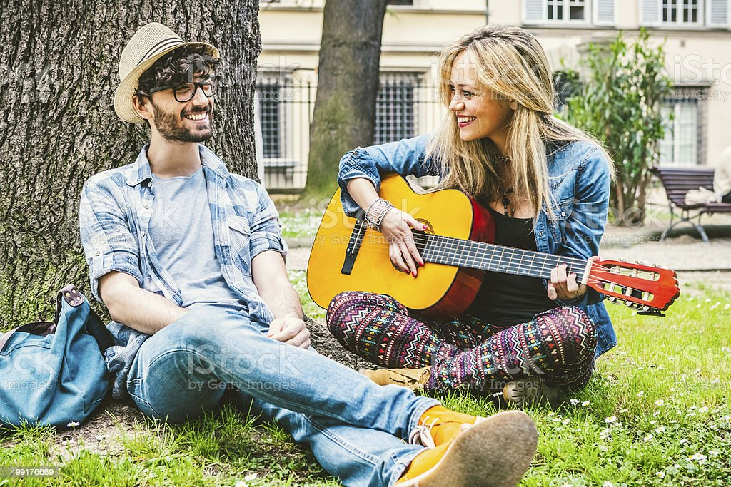 College Students Relaxing with a Guitar stock photo