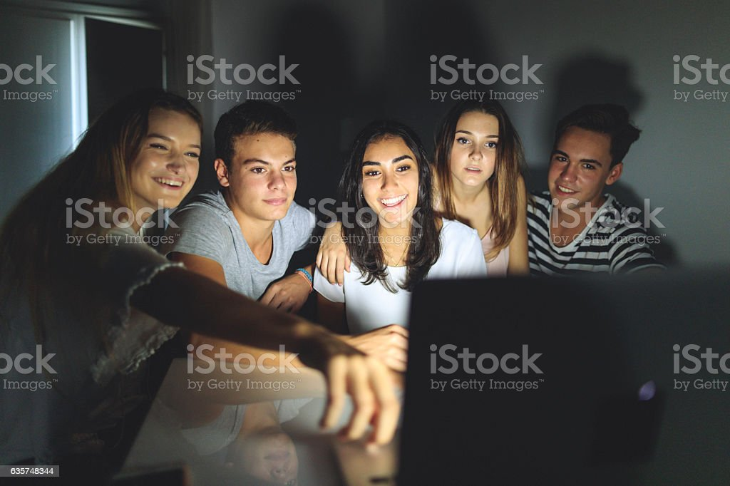 College students social networking together at home stock photo