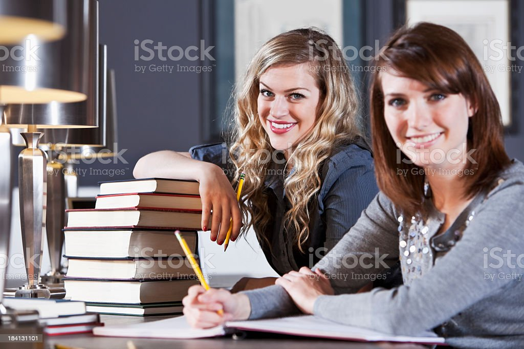 College students studying in library reading room stock photo