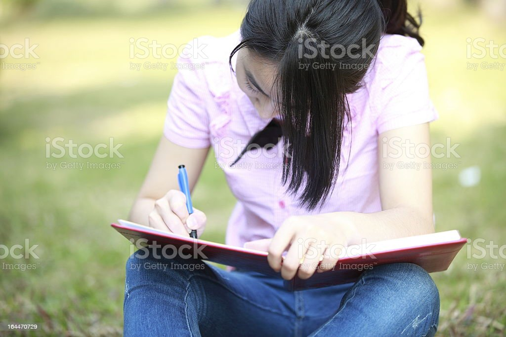 College students studying outdoor royalty-free stock photo