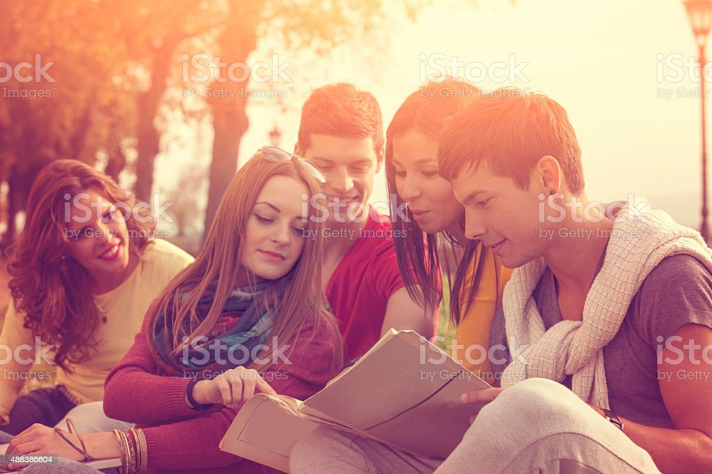 College students studying outside stock photo