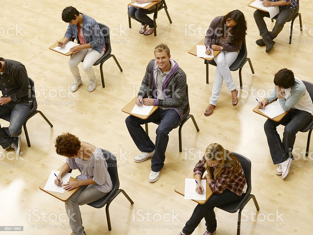 College students taking test in classroom royalty-free stock photo