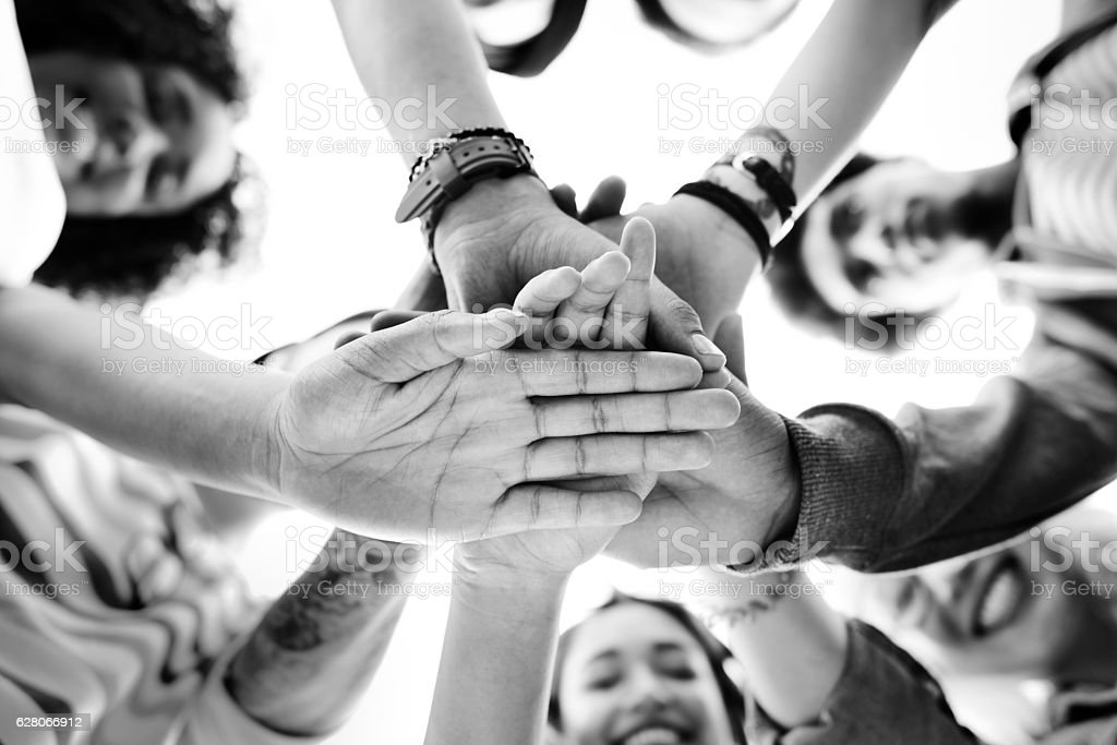 College Students Teamwork Stacking Hand Concept stock photo