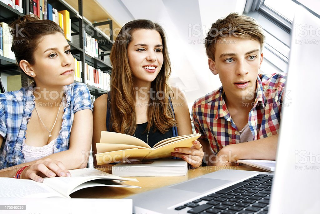 College Students With Laptop On Table stock photo