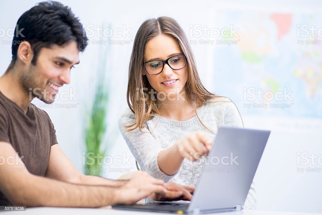 College Students Working on a Paper stock photo