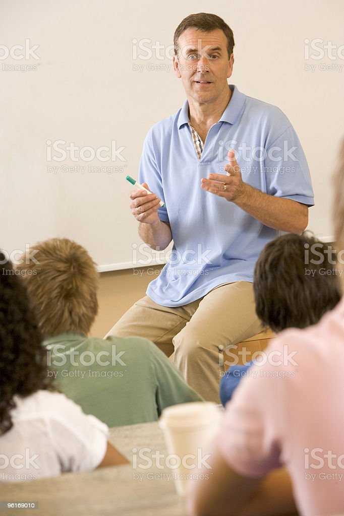 College teacher giving a lecture royalty-free stock photo
