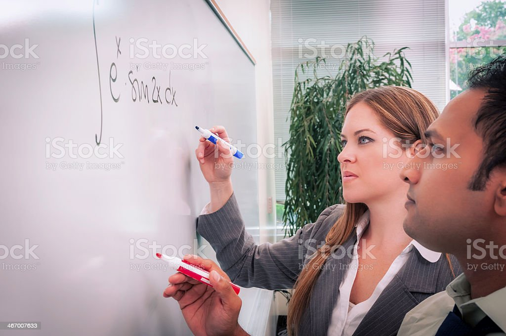 College/university students solving math problem - II royalty-free stock photo