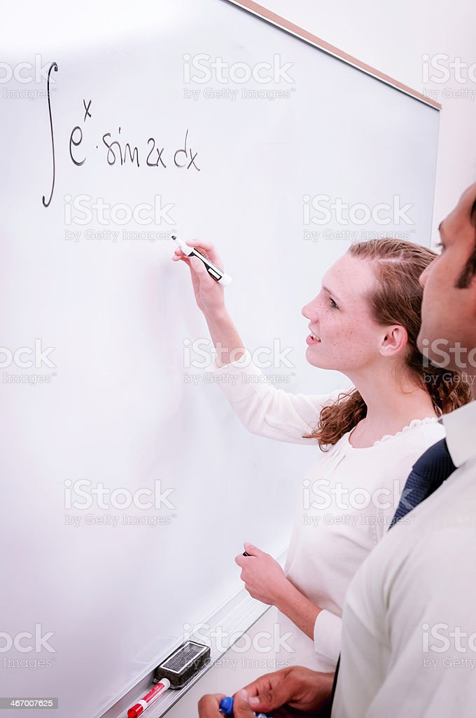 College/university students solving math problem - VI royalty-free stock photo
