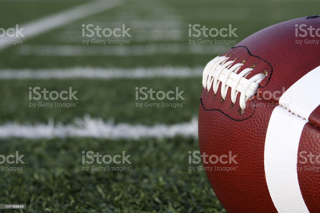 Collegiate Football with yard lines beyond stock photo