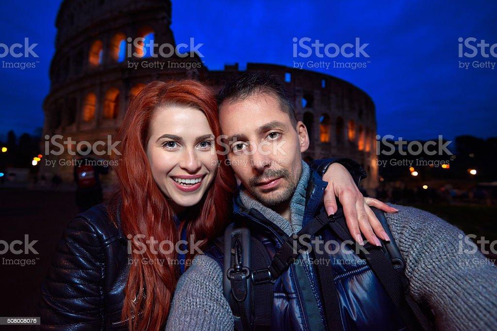 Colliseum couple stock photo