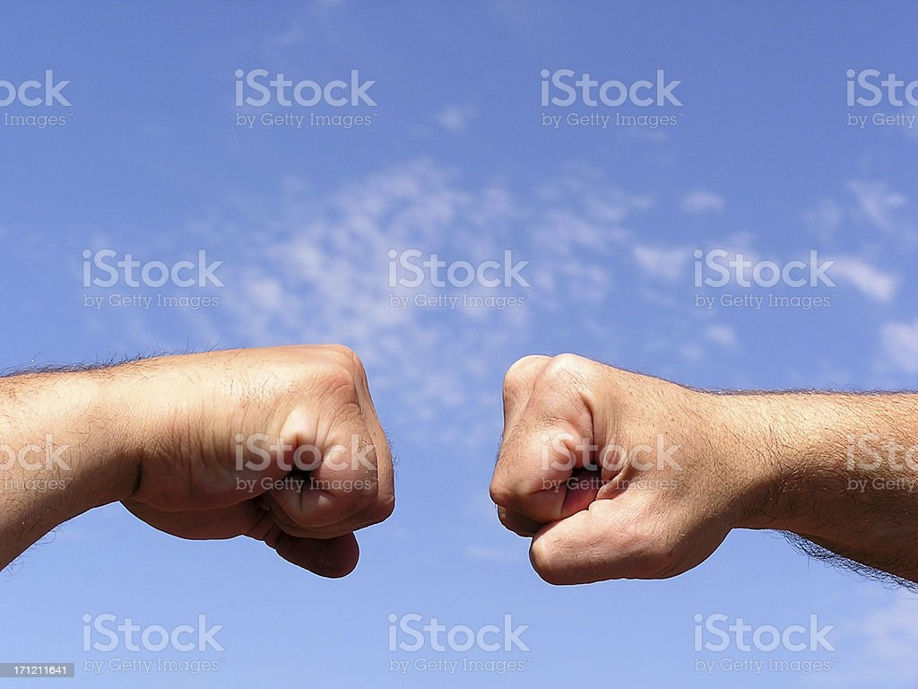 Collision Course Fists royalty-free stock photo