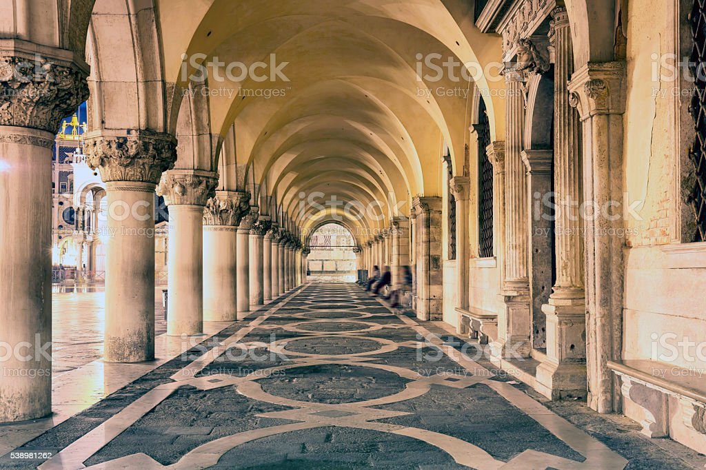 Collonnade of Doge's Palace in Venice at night stock photo