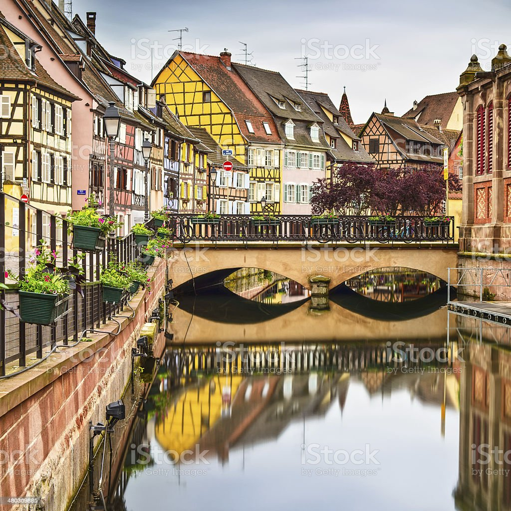 Colmar, Petit Venice, bridge, water canal, traditional houses. A stock photo