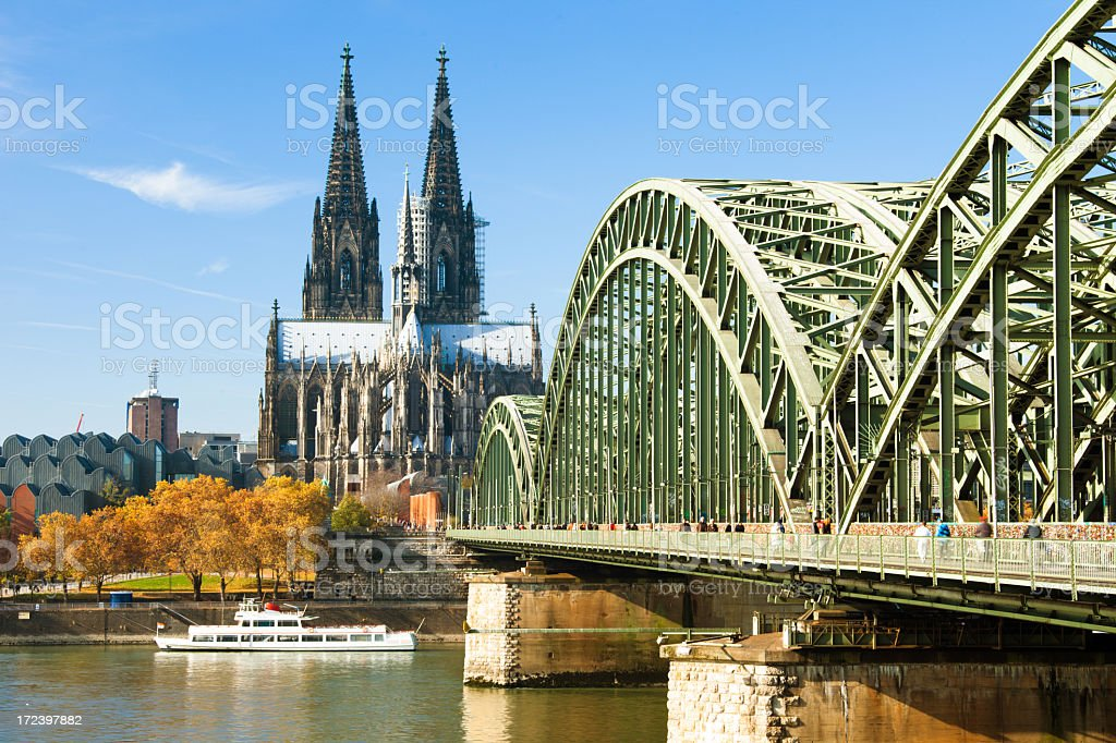 Cologne cathedral and bridge in Germany stock photo