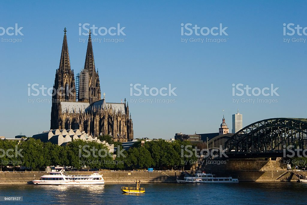 Cologne Cathedral and Hohenzollern Bridge with boat passing stock photo