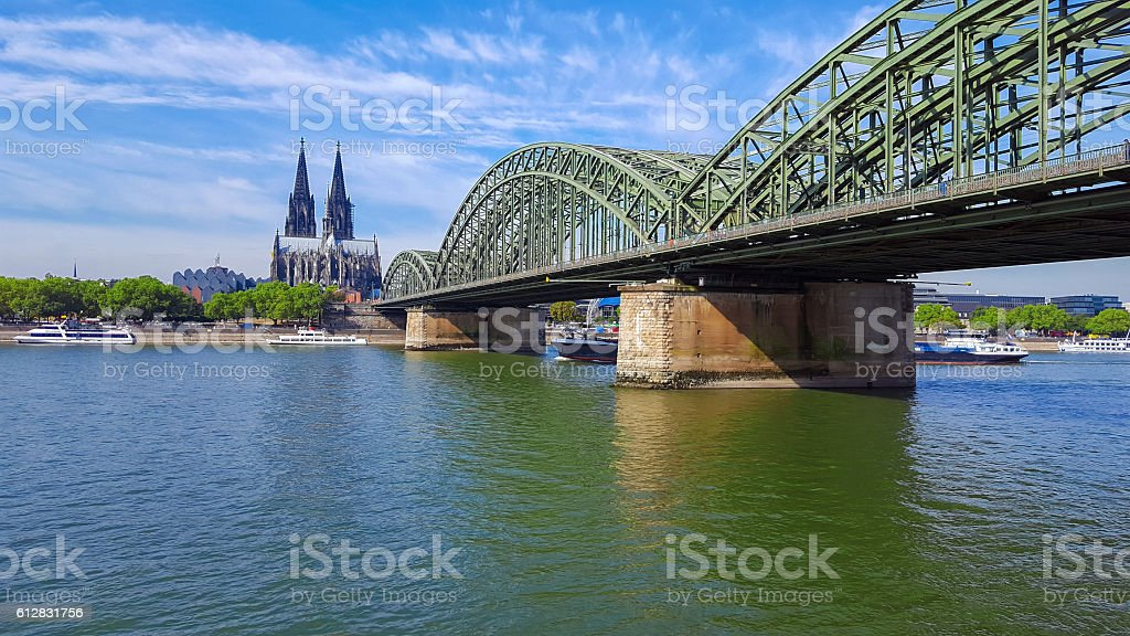 Cologne Cathedral and Hohenzollern bridge with freighter stock photo