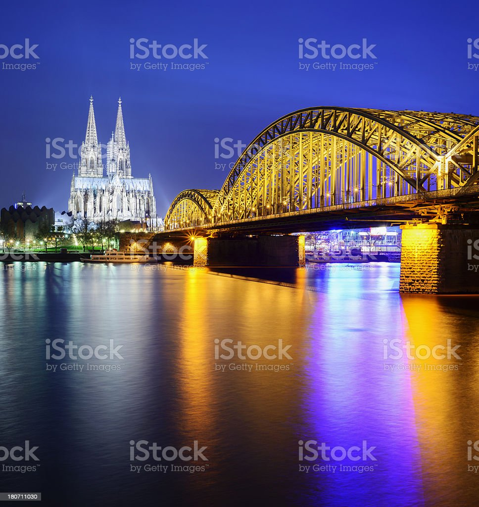 Cologne Cathedral and the Hohenzollern Bridge at  Night in Germany royalty-free stock photo
