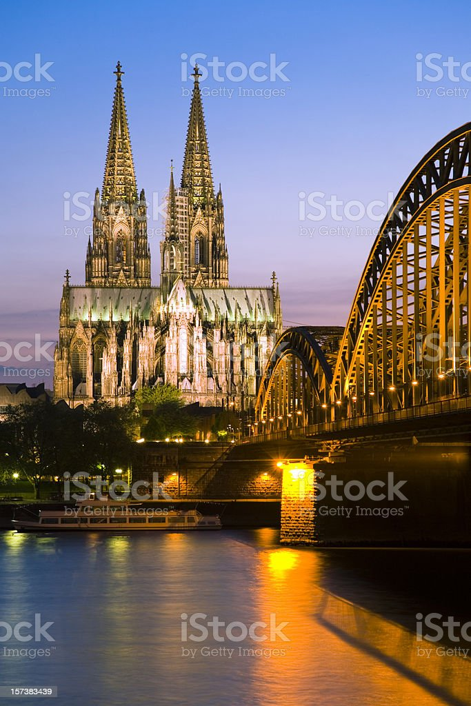 Cologne cathedral and the Hohenzollern bridge at twilight stock photo