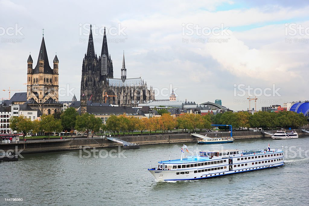 cologne cathedral and tourboat stock photo