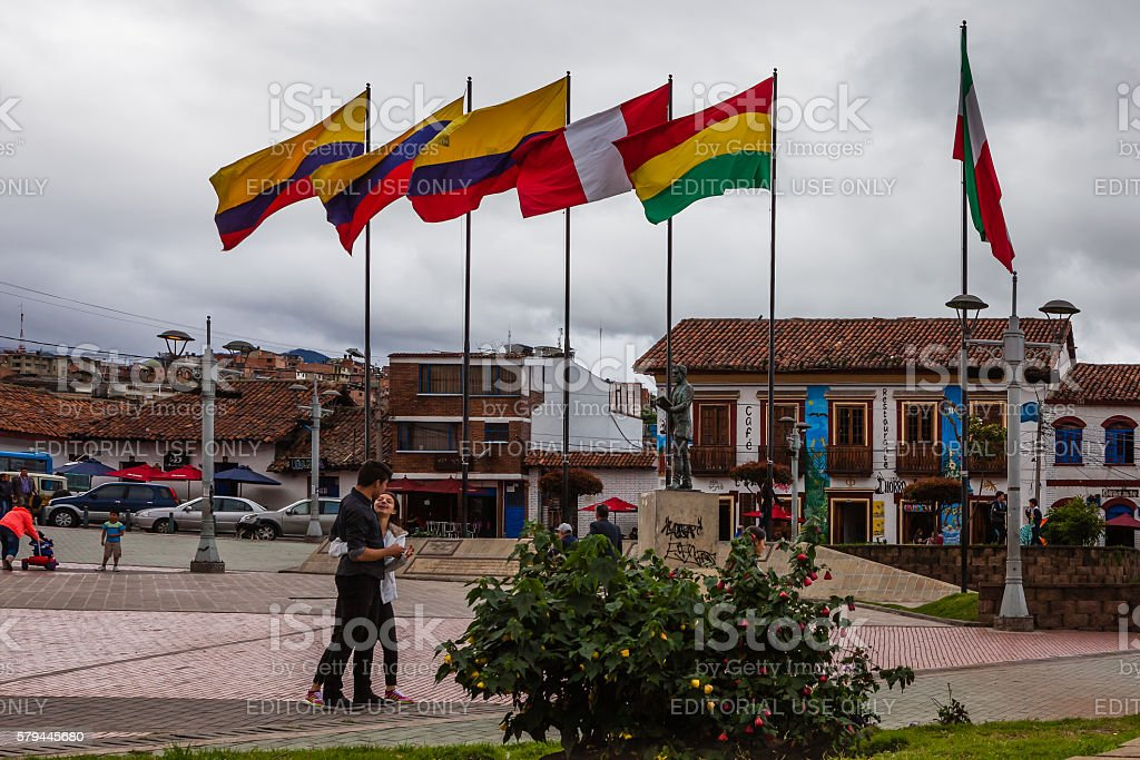 Colombia: Flags and local people on Independence Square in Zipaquirá stock photo