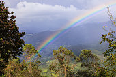 Colombia - Rainbow over the Andes Mountains. Pastoral Scene.