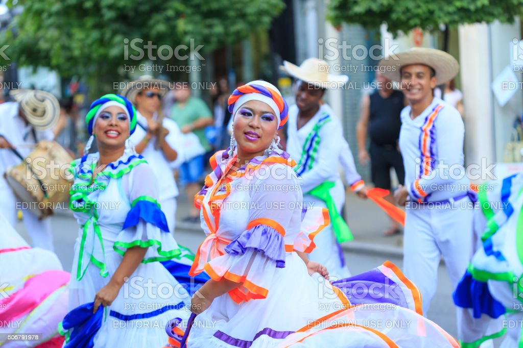 Colombian girls from group for traditional folklore in festival stock photo