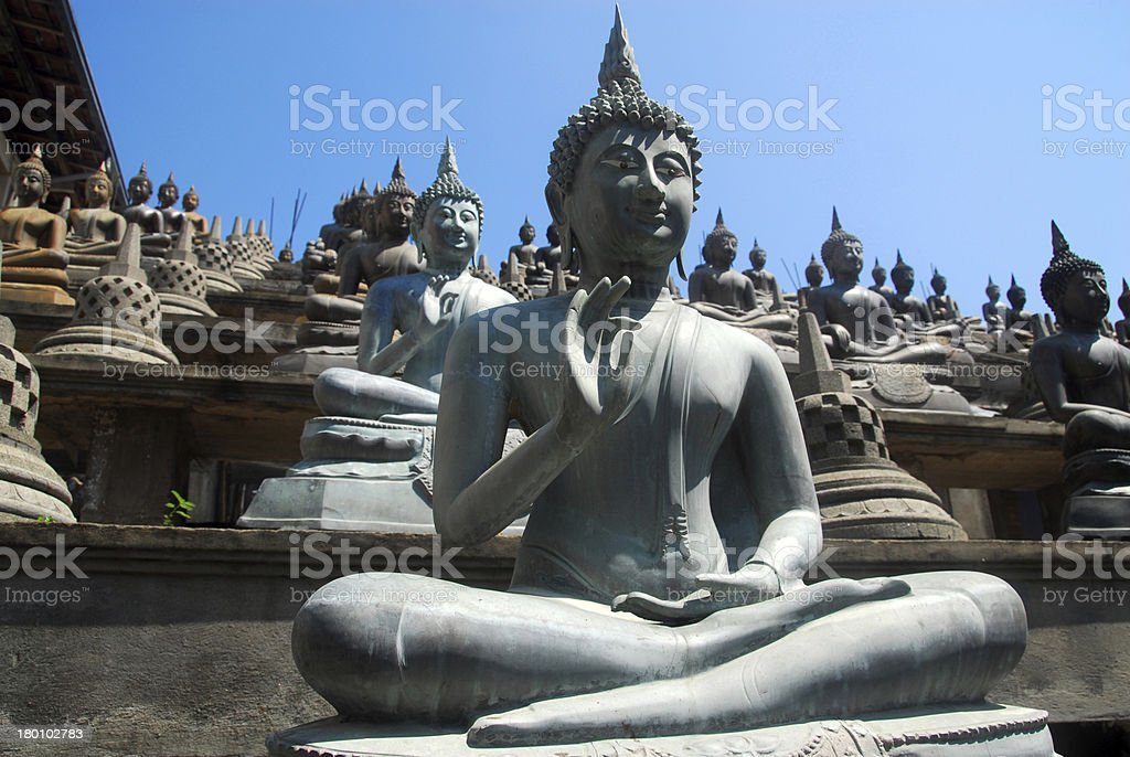 Colombo, Sri Lanka: Gangaramaya Temple, Vitarka Mudra Buddha gesture stock photo