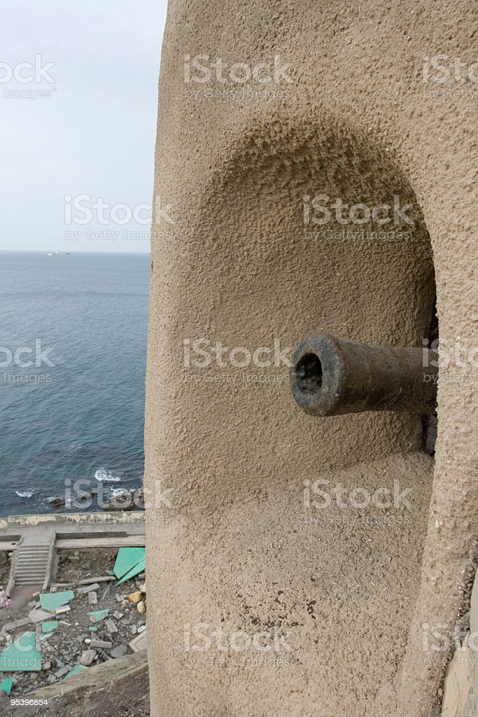 Colonial canon pointing to the sea royalty-free stock photo